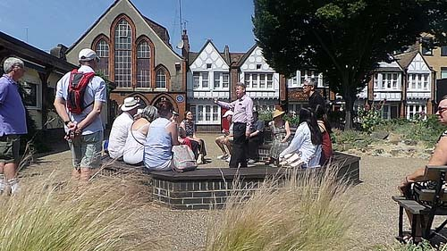 Richard Jones guiding a Charles Dickens tour in Redcross Garden.