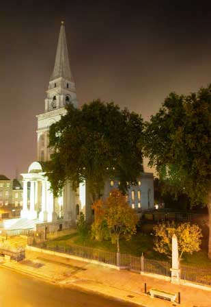 A highlight of our Jack the Ripper guided tour is the soaring white spire of Christchurch Spitalfields seen here by night.
