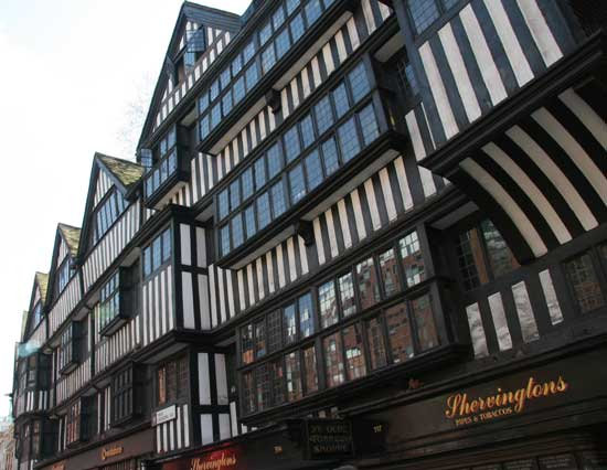 The black and white timbered facade of Staple Inn.